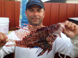 Capt. Mike Murias with the new All-Tackle lionfish